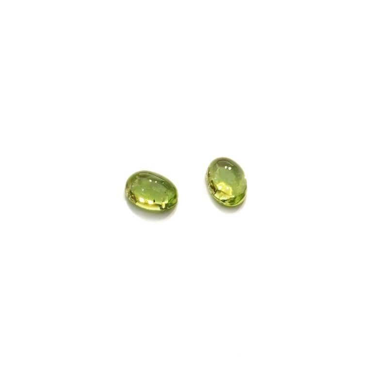 Péridot couper Cabocon 0.95 carats 5.00 x 7.00 mm